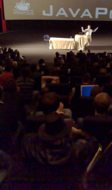Neal Gafter (black hat) watching Josh Bloch's presentation at JavaPolis 2007